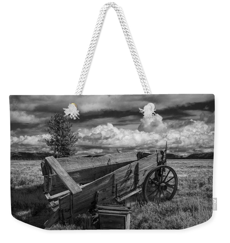 Art Weekender Tote Bag featuring the photograph Abandoned Broken Down Frontier Wagon In Black And White by Randall Nyhof