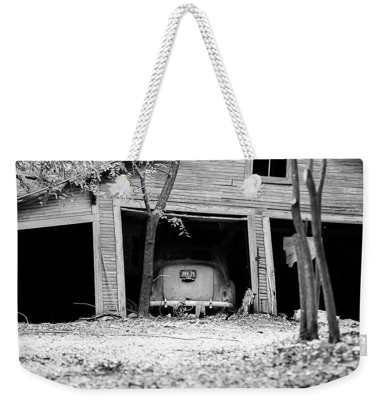 Black And White Weekender Tote Bag featuring the photograph Abandoned by Charles Holloman