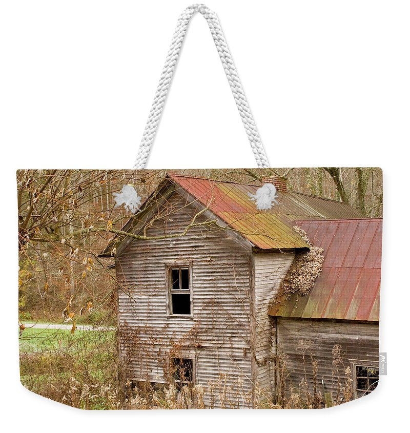 Abandoned Weekender Tote Bag featuring the photograph Abandoned House With Colorful Roof by Douglas Barnett