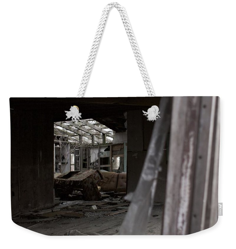 Abandoned Weekender Tote Bag featuring the photograph Abandoned by Jordan Mayle