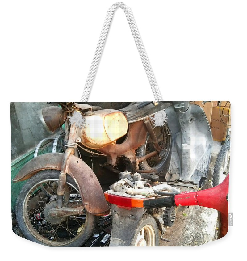 Mototbike Weekender Tote Bag featuring the photograph Abandoned Motorbike by Heather Lennox