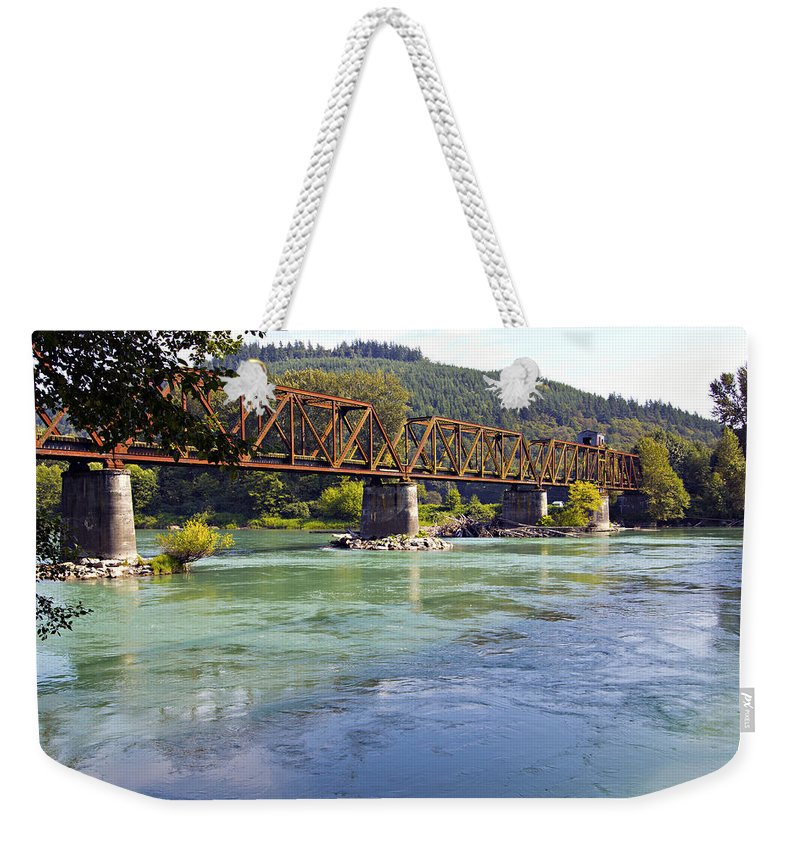 Abandoned Weekender Tote Bag featuring the photograph Abandoned Railroad Bridge by Paul Fell