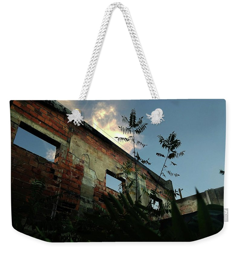 Dilapidated Weekender Tote Bag featuring the photograph Abandoned Theater Oasis by Aaron James