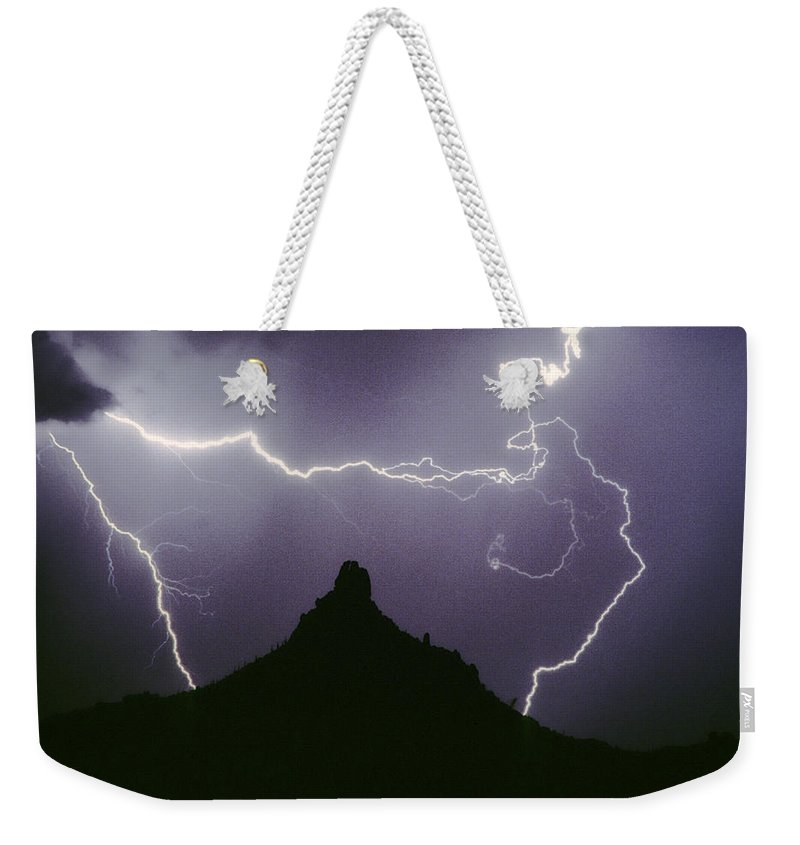 Lightning Weekender Tote Bag featuring the photograph Above And Beyond Pinnacle Peak by James BO Insogna