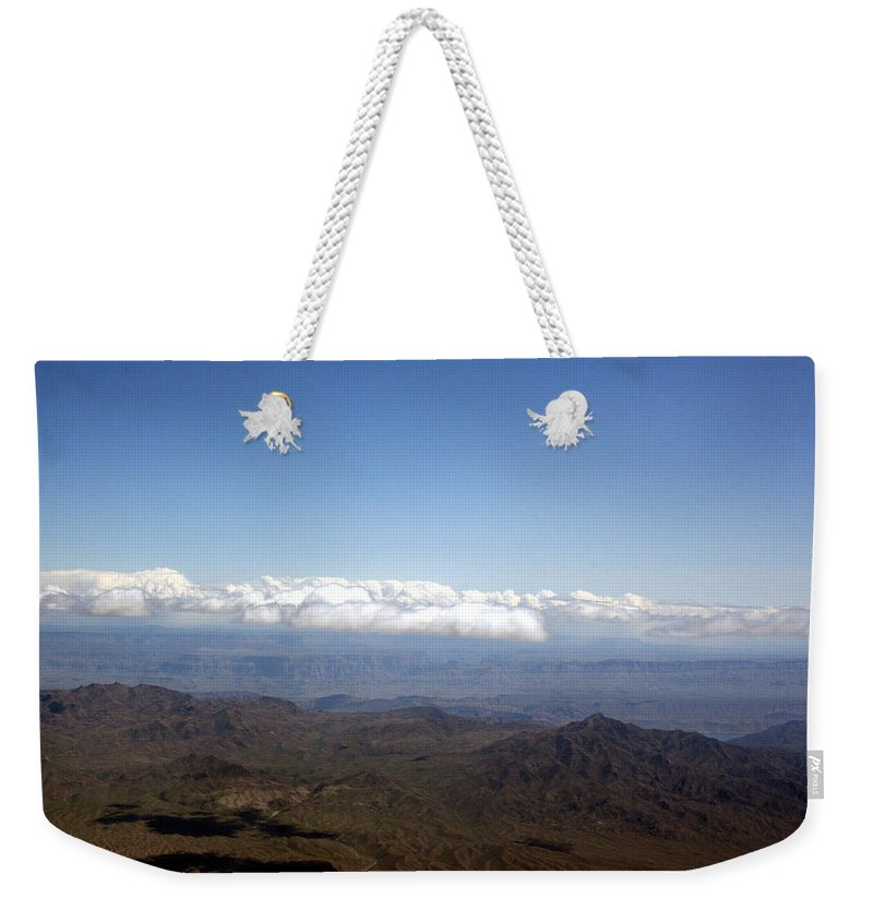 Nevada Desert Clouds Scenery Hills Landscape Sky Canyon Weekender Tote Bag featuring the photograph Above Nevada by Andrea Lawrence