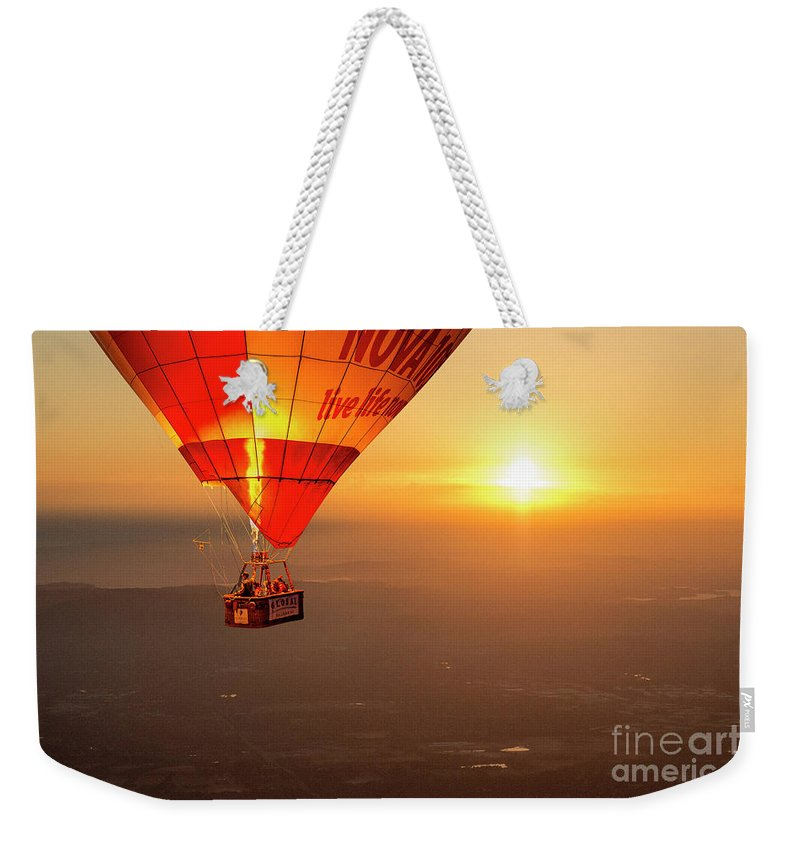 Balloon Weekender Tote Bag featuring the photograph Adrift In The Mist At Sunrise by Ray Warren