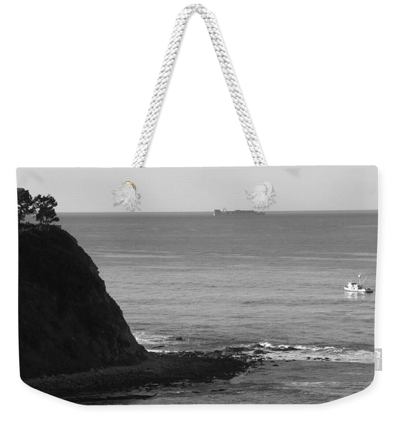 Ocean Weekender Tote Bag featuring the photograph Adrift by Shari Chavira