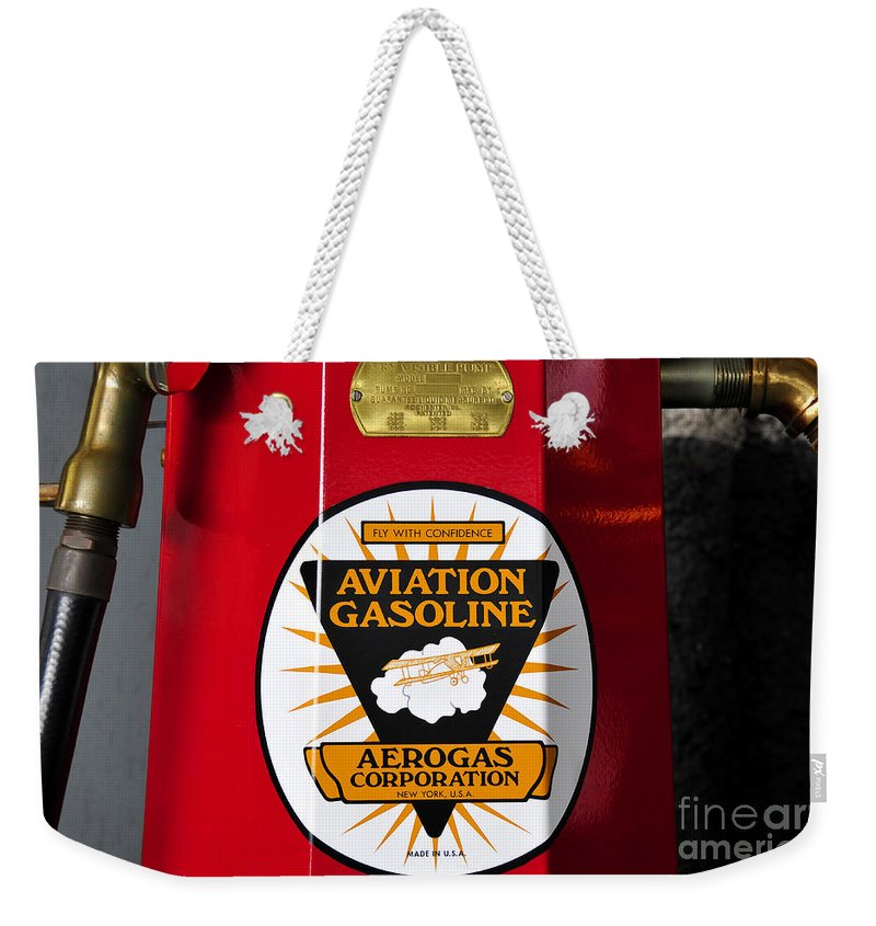 Fine Art Photography Weekender Tote Bag featuring the photograph Aerogas Red Pump by David Lee Thompson