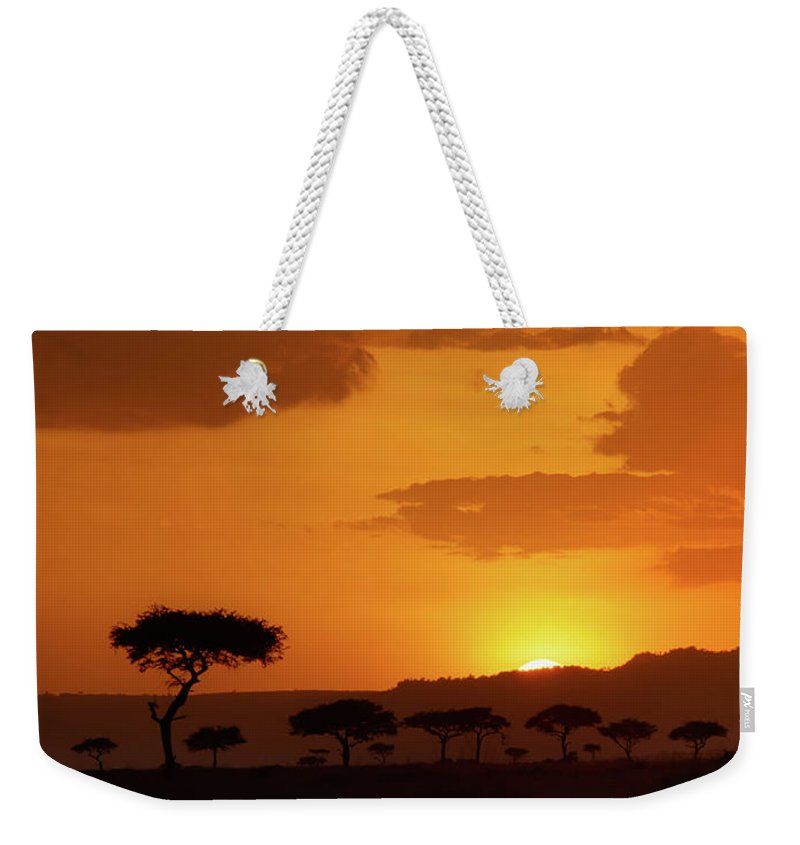 Africa Weekender Tote Bag featuring the photograph African Sunrise by Sebastian Musial