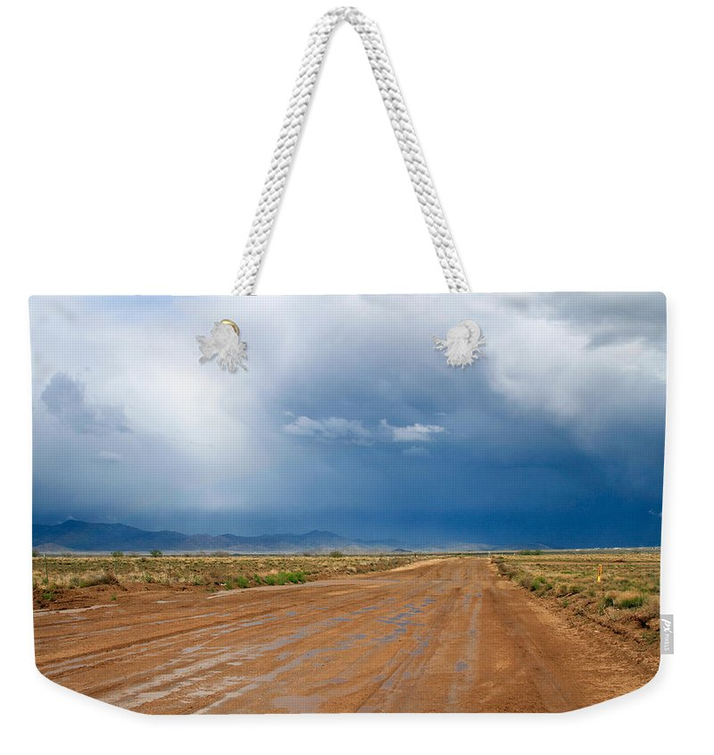 After The Rain Weekender Tote Bag featuring the photograph After The Rain by Bonnie Follett