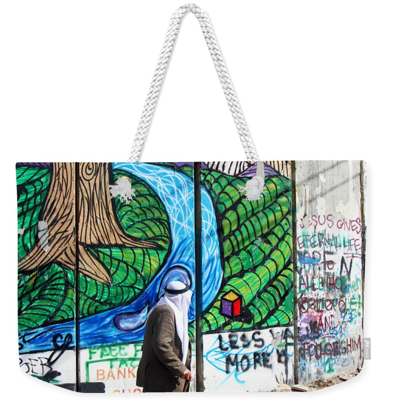Wall Weekender Tote Bag featuring the photograph Against The Norm by Munir Alawi