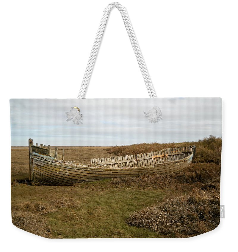 England Weekender Tote Bag featuring the photograph Aged Skeleton by Julia Raddatz