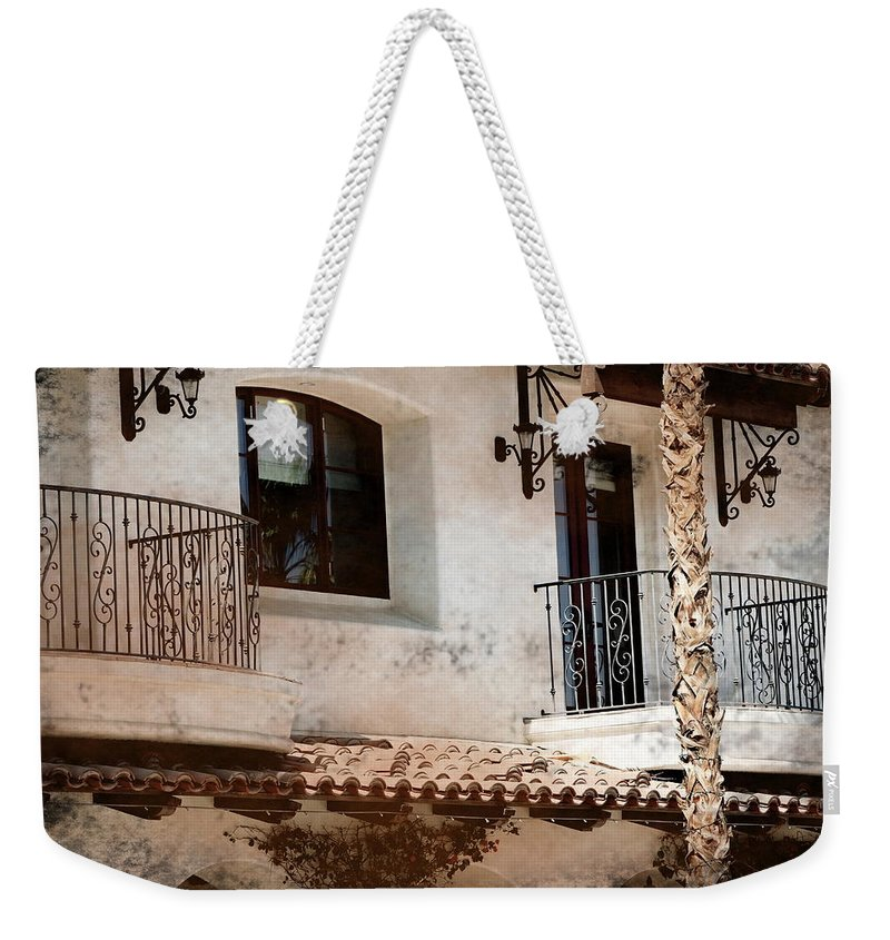 Aged Photograph Weekender Tote Bag featuring the photograph Aged Stucco Building Balcony with Terracotta Roof by Colleen Cornelius