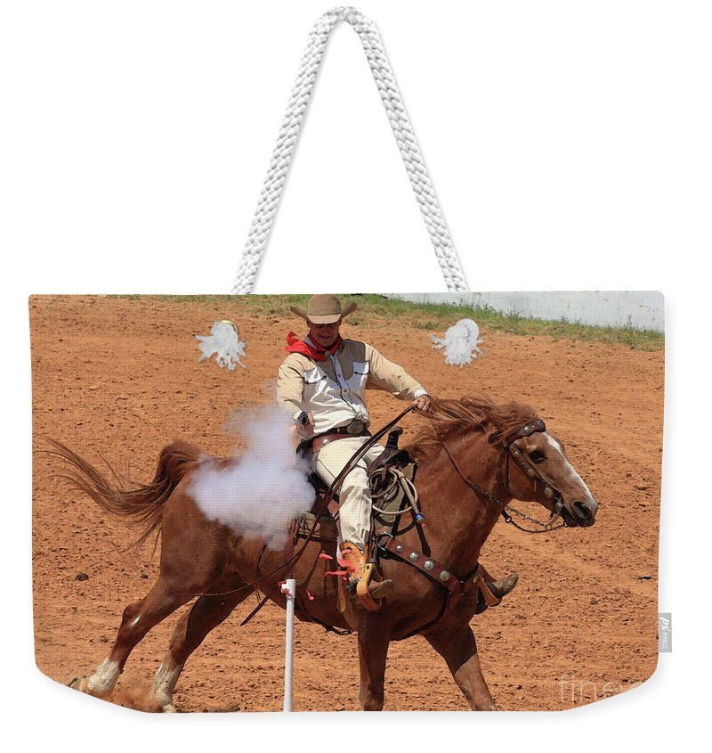 Western Art Weekender Tote Bag featuring the photograph Aim..fire..pop by Kim Henderson