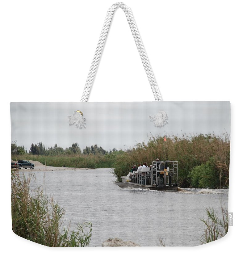 Everglades Weekender Tote Bag featuring the photograph Airboat Rides 25 Cents by Rob Hans