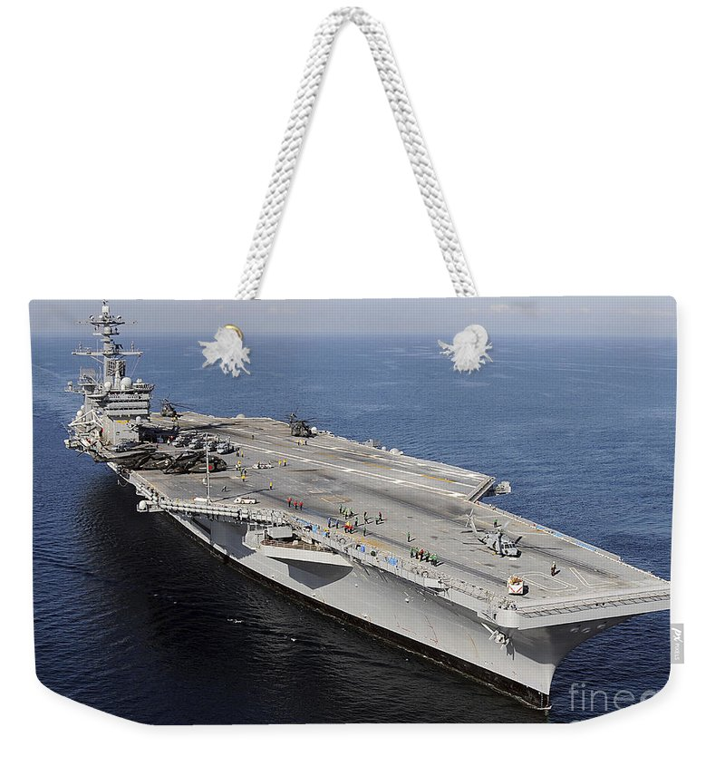 Us Navy Weekender Tote Bag featuring the photograph Aircraft Carrier Uss Carl Vinson by Stocktrek Images