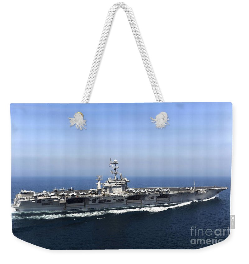 Operation New Dawn Weekender Tote Bag featuring the photograph Aircraft Carrier Uss John C. Stennis by Stocktrek Images