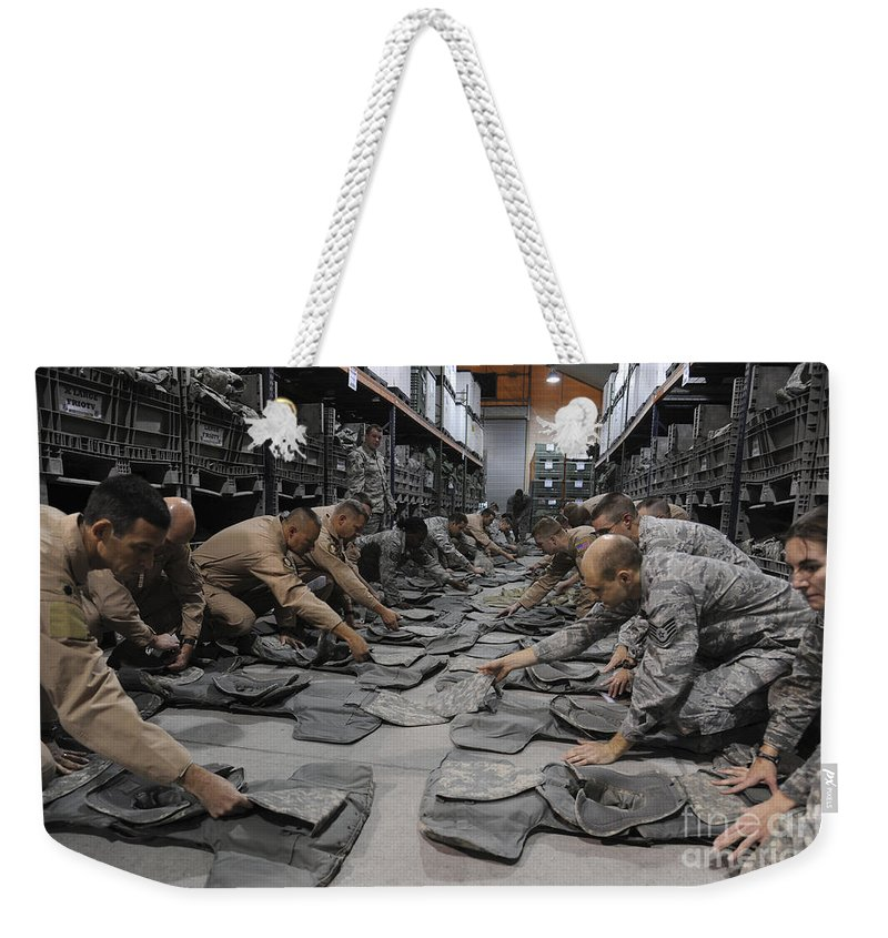 Kyrgyzstan Weekender Tote Bag featuring the photograph Airmen Inspect Their Improved Outer by Stocktrek Images