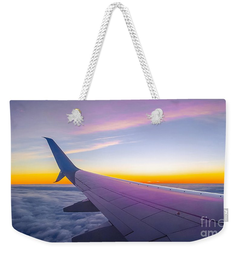 Plane Weekender Tote Bag featuring the photograph Airplane Window by Sebastien Coell