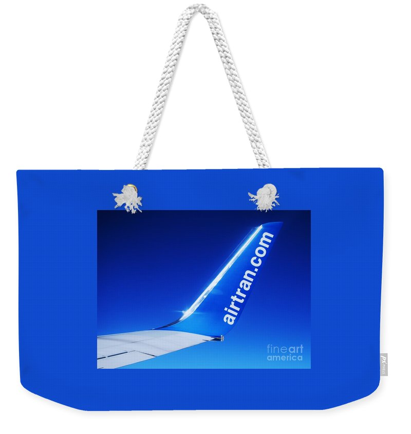 Aviation Travel Airtran Sky Airplane Wing Logo Stock Shot Collectors Piece Color Blue Photography Aerial Adventure Collectible Metal Frame Highly Recommended Canvas Print Poster Print Available On Phone Cases Pouches Throw Pillows Weekender Tote Bags T Shirts Tote Bags Mugs And Shower Curtains Weekender Tote Bag featuring the photograph Collectible Airtran Wing by Marcus Dagan