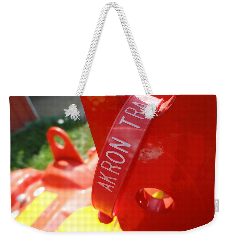 Red Weekender Tote Bag featuring the photograph Akron Tractor by Trish Hale
