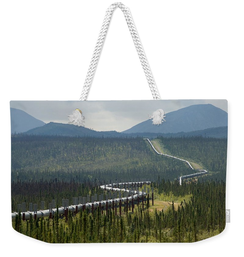 Nobody Weekender Tote Bag featuring the photograph Alaska Pipeline Heading South Thru by Michael S. Quinton