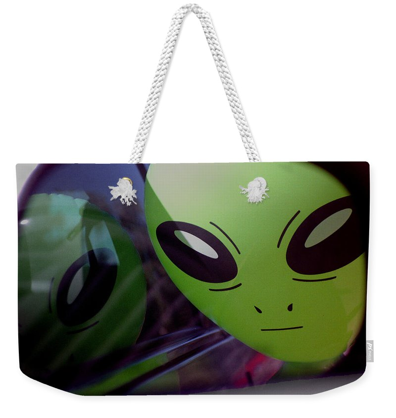 Alien Weekender Tote Bag featuring the photograph Alien Is Closer Than He Appears by Richard Henne