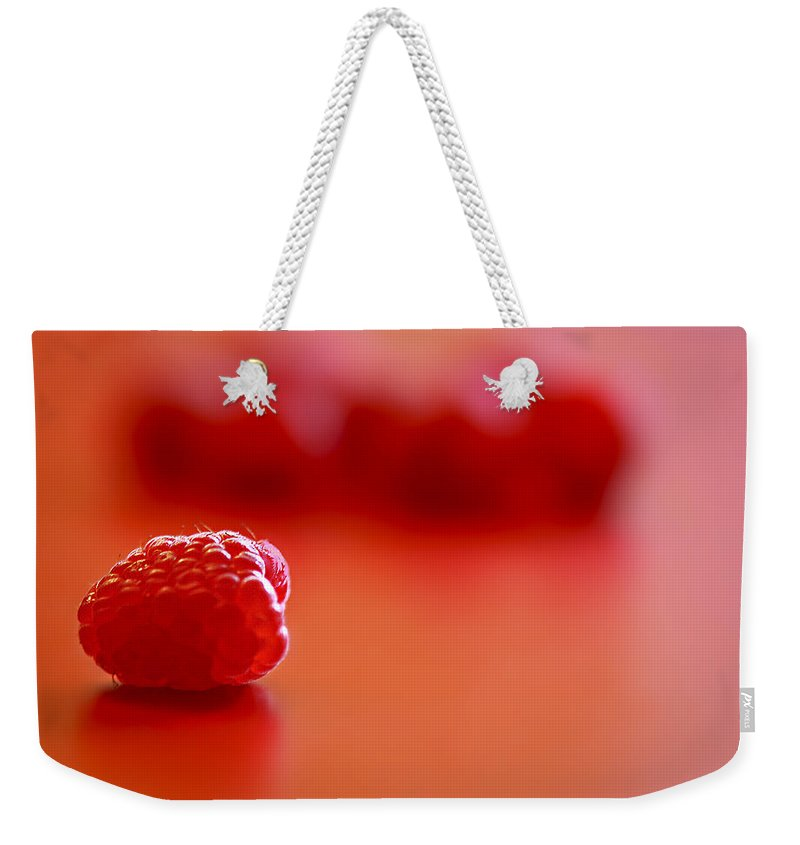 Red Weekender Tote Bag featuring the photograph All Alone by Evelina Kremsdorf