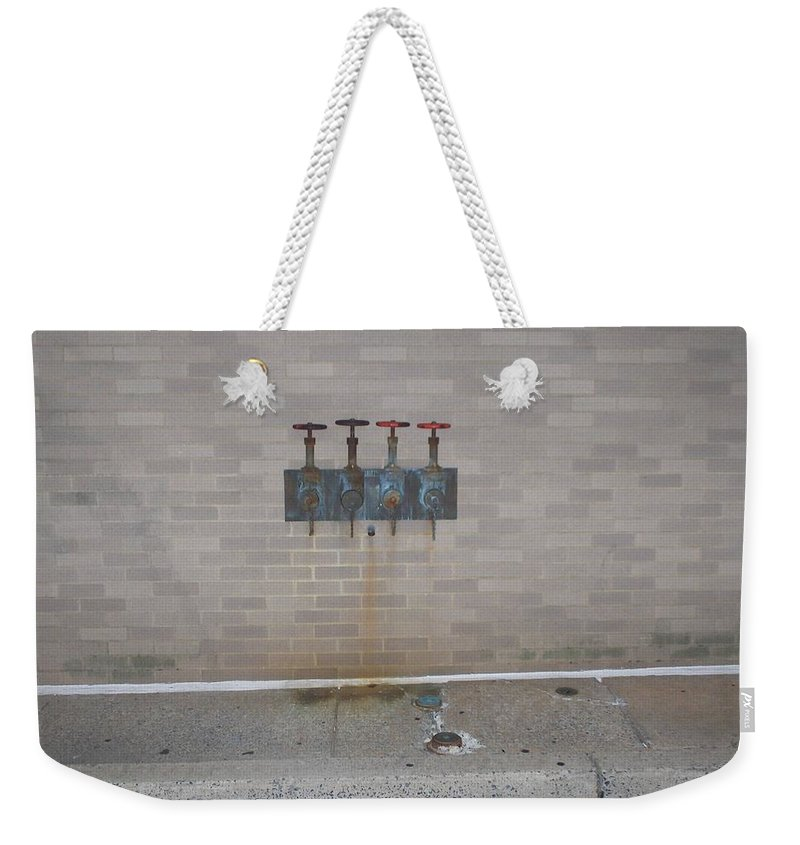Photograph Weekender Tote Bag featuring the photograph All Alone Four Pipes by Thomas Valentine