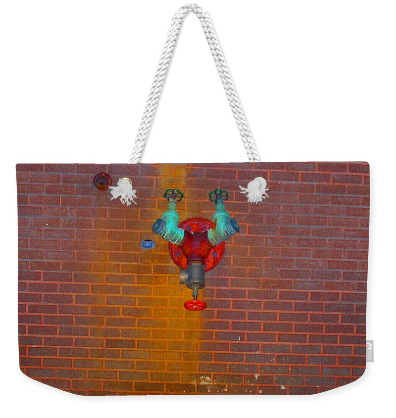 Photograph Weekender Tote Bag featuring the photograph All Alone Red Pipe by Thomas Valentine