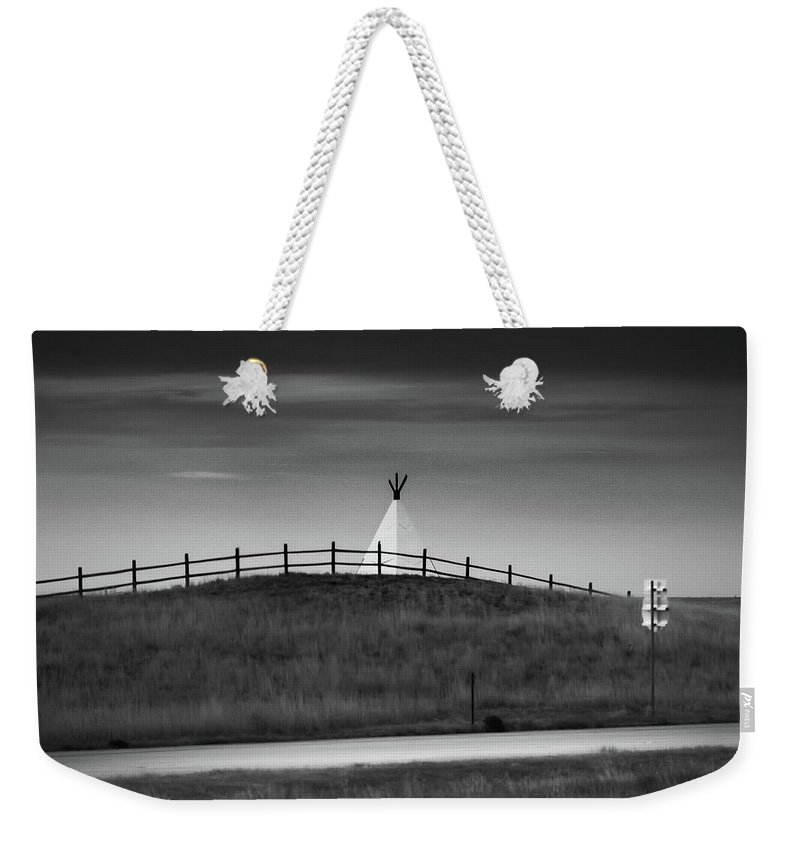 Teepee Weekender Tote Bag featuring the photograph All That Remains by Jonas Ogrefoln