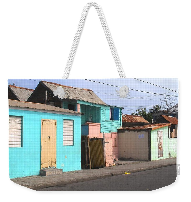 St Kitts Weekender Tote Bag featuring the photograph Along Bay Road by Ian MacDonald