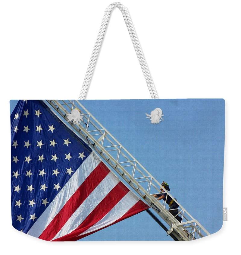 American Weekender Tote Bag featuring the photograph American Firefighter by Sarah Houser