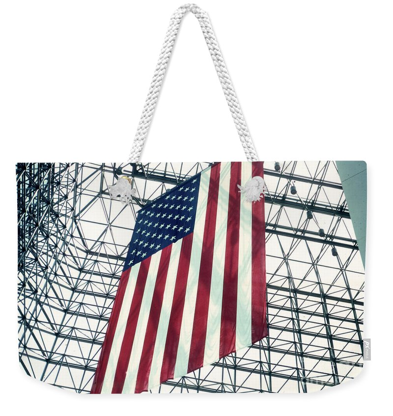Flag Weekender Tote Bag featuring the photograph American Flag In Kennedy Library Atrium - 1982 by Thomas Marchessault
