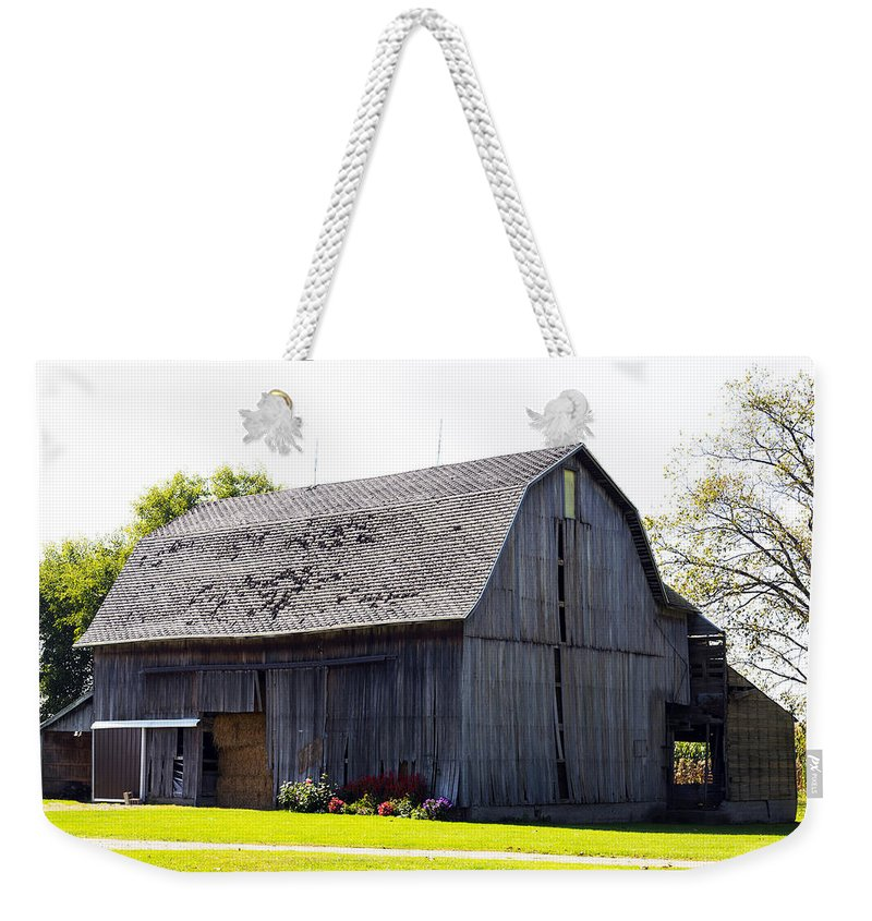 Horizontal Weekender Tote Bag featuring the photograph Amish Barn With Gambrel Roof And Hay Bales Indiana Usa by Sally Rockefeller