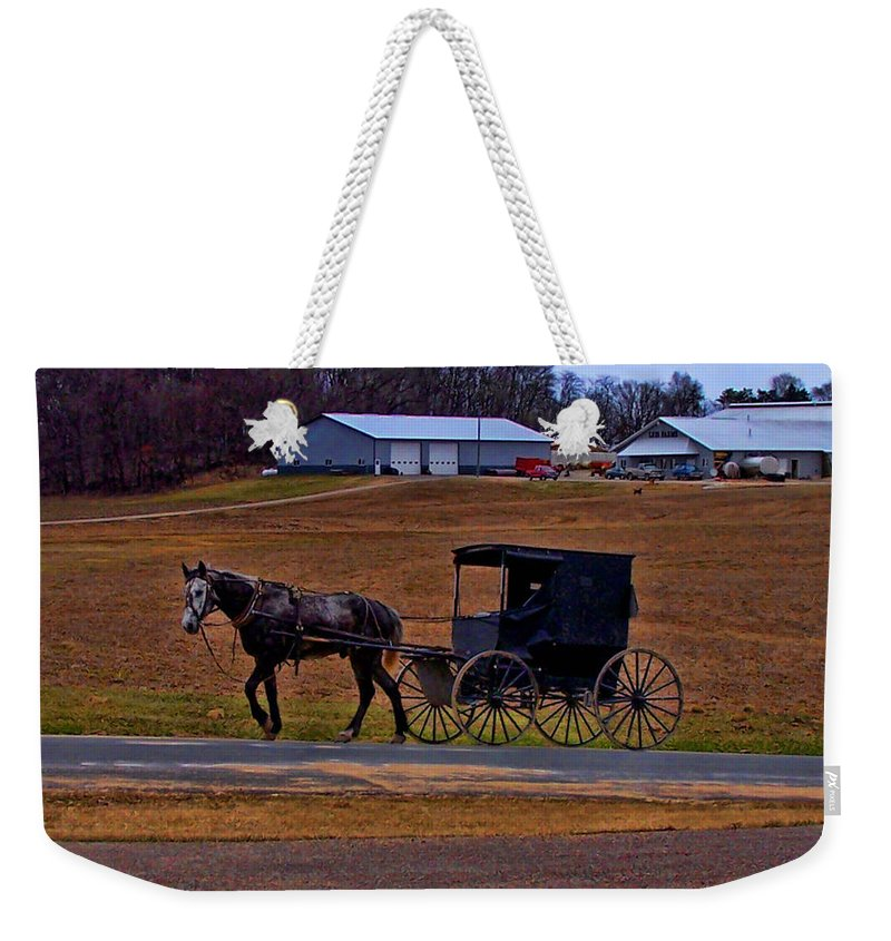 Wisconsin Weekender Tote Bag featuring the photograph Amish Buggy by Tommy Anderson