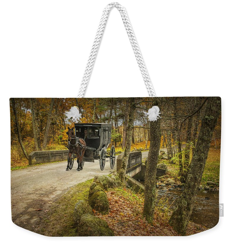 Buggy Weekender Tote Bag featuring the photograph Amish Horse And Buggy Crossing A Bridge by Randall Nyhof