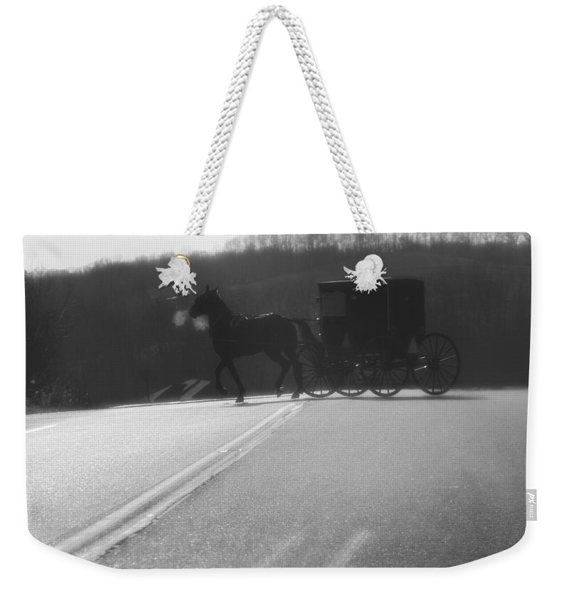 Amish Horse And Buggy In Winter Weekender Tote Bag featuring the photograph Amish Horse And Buggy In Winter by Dan Sproul