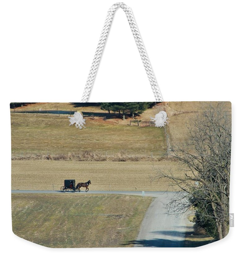 Amish Horse And Buggy In Ohio Weekender Tote Bag featuring the photograph Amish Horse And Buggy On A Country Road by Dan Sproul