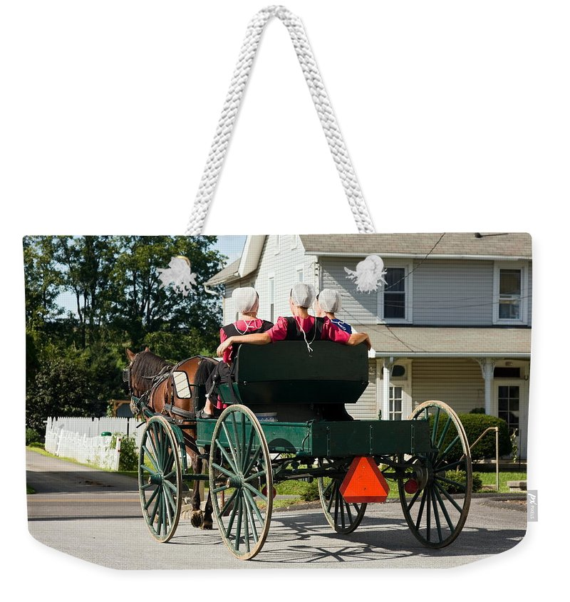 Amish Women Riding In Open Horse Drawn Cart Weekender Tote Bag featuring the photograph Amish Women by Sally Weigand