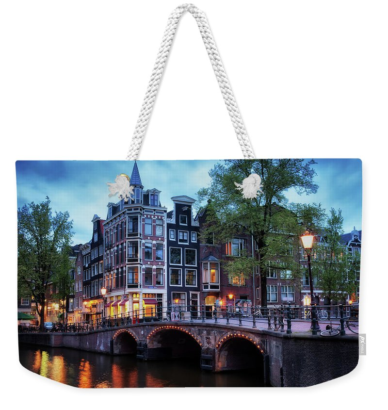 Amsterdam Weekender Tote Bag featuring the photograph Amsterdam At Twilight by Artur Bogacki