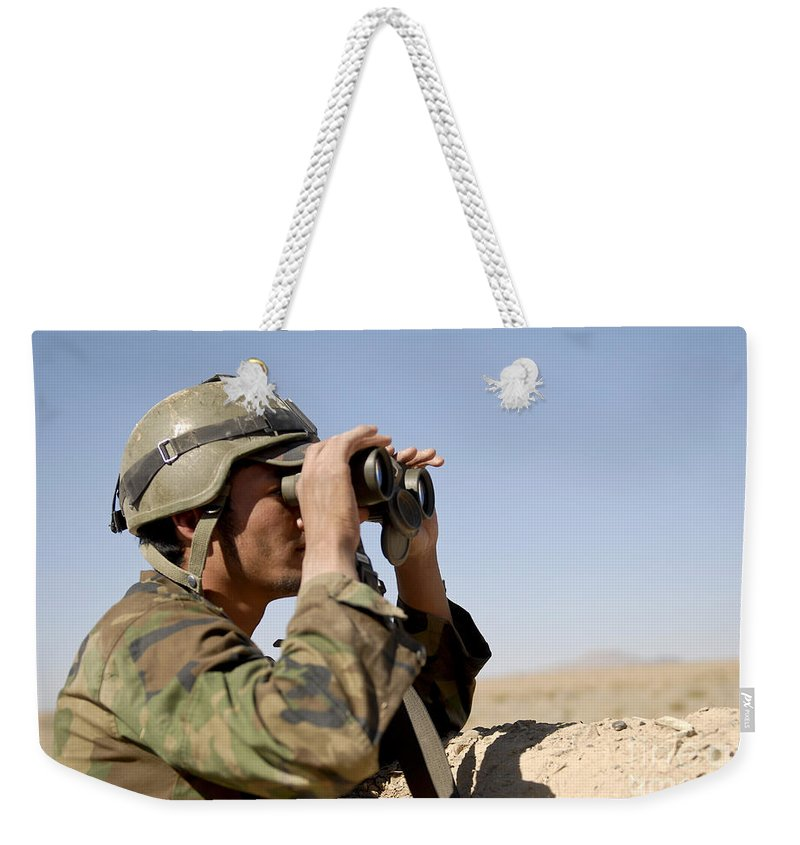 Afghanistan Weekender Tote Bag featuring the photograph An Afghan Commando Scans The Horizon by Stocktrek Images