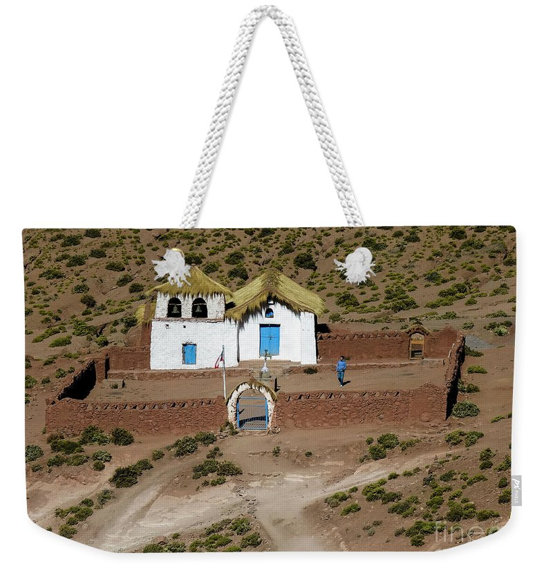 Church Weekender Tote Bag featuring the photograph The Ancient Church At Machuca In The Atacama Desert by Kenneth Lempert