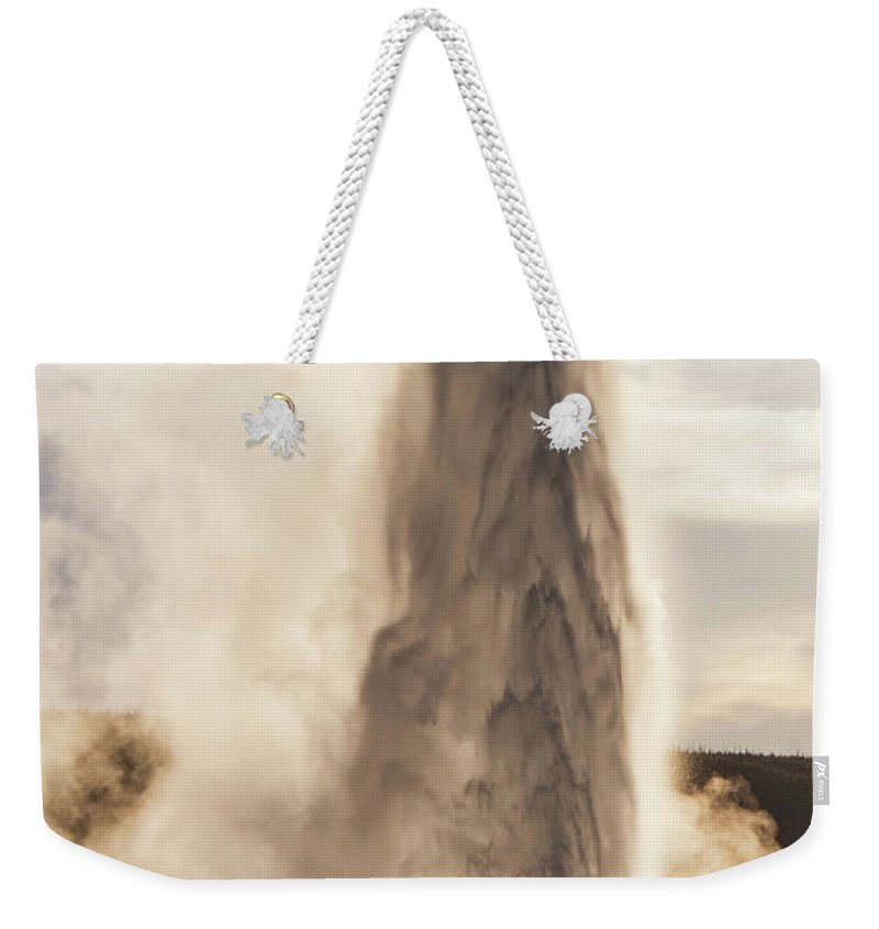 Yellowstone Weekender Tote Bag featuring the photograph An Evening With Old Faithful by Janet Jones