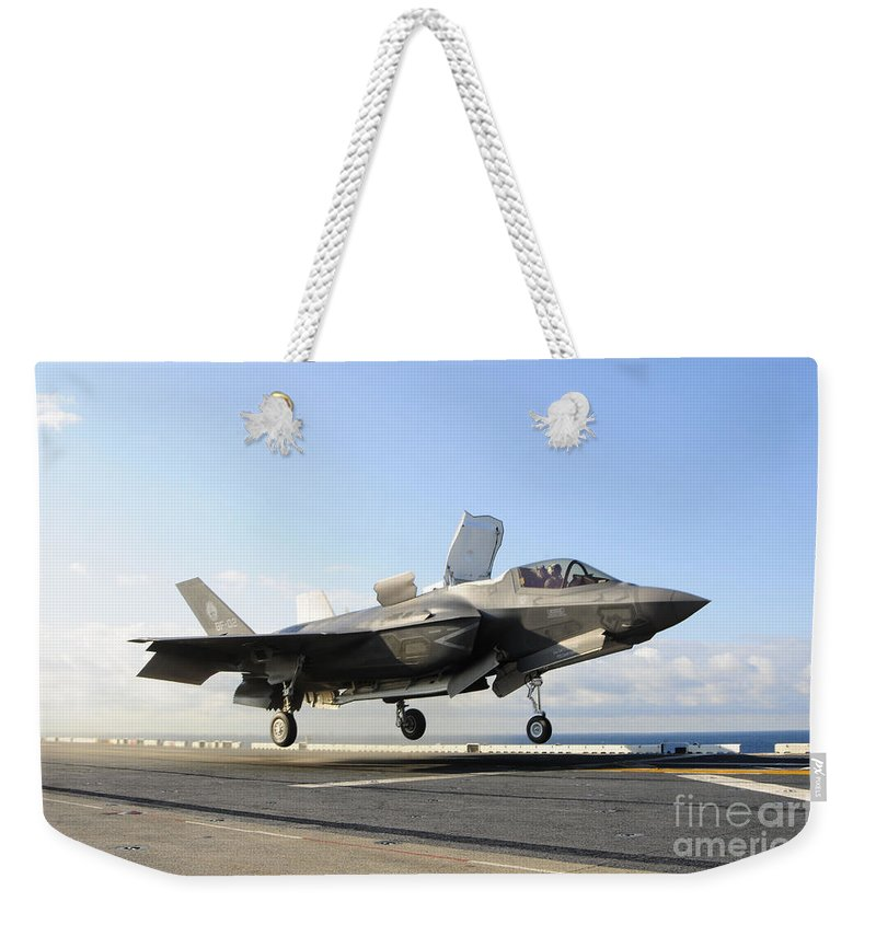 Maritime Weekender Tote Bag featuring the photograph An F-35b Lightning II Lifts by Stocktrek Images