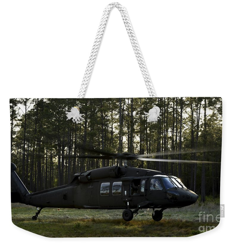Exercise Emerald Warrior Weekender Tote Bag featuring the photograph An Hh-60 Pave Hawk Evacuates Injured by Stocktrek Images