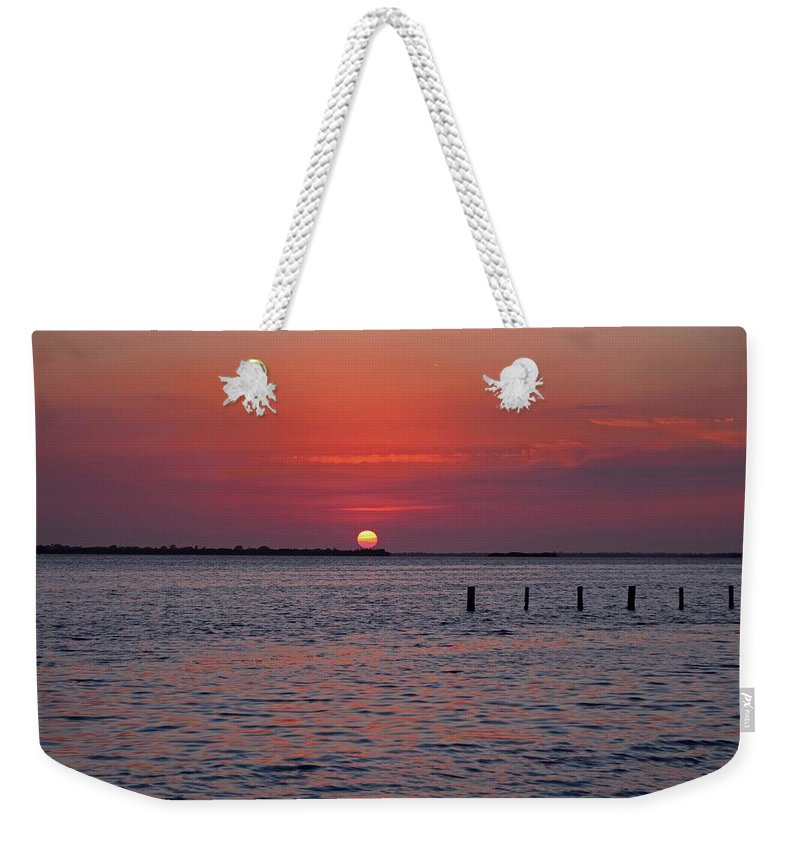 Caloosahatchee Weekender Tote Bag featuring the photograph An Illuminating Memoir by Michiale Schneider
