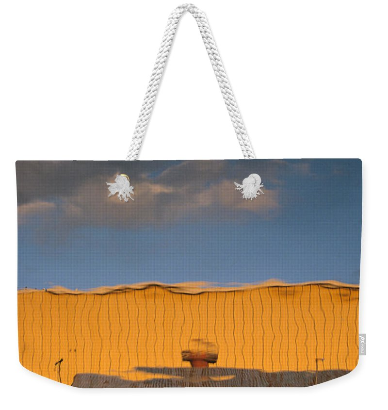 Dock Weekender Tote Bag featuring the photograph An Illusion Created By A Reflection by John Harmon