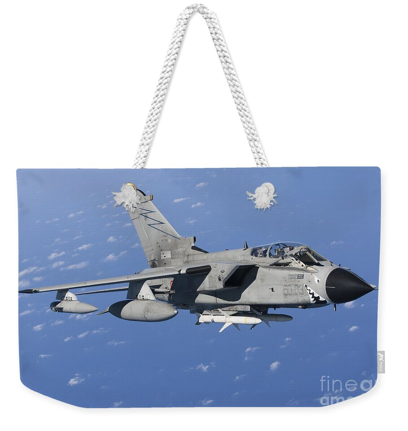 50 Stormo Weekender Tote Bag featuring the photograph An Italian Air Force Tornado Ids Armed by Gert Kromhout