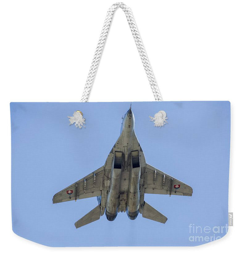 Ostrava Weekender Tote Bag featuring the photograph An Mig-29as Fulcrum Of The Slovak Air by Timm Ziegenthaler